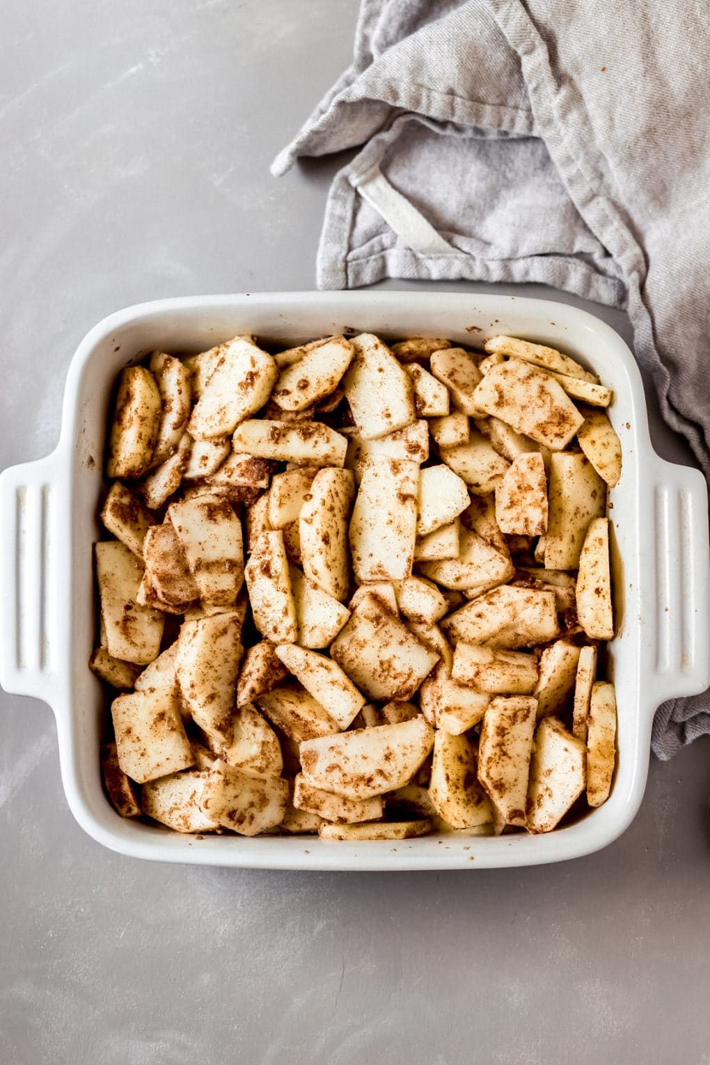 sliced apples in a baking dish