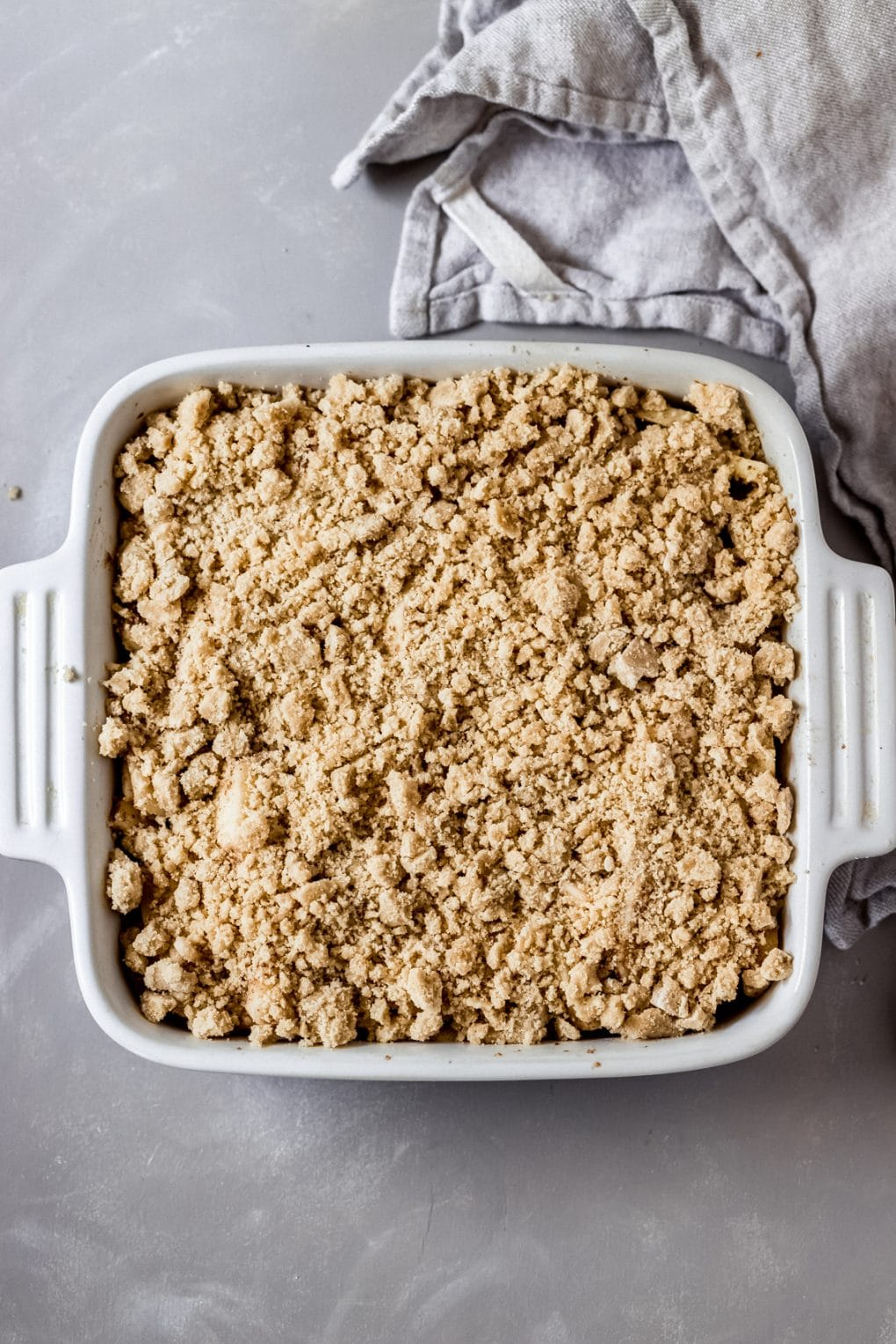 an baking dish of unbaked apple pie shortbread bars