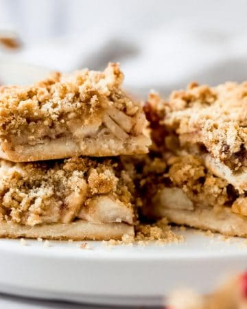 several apple pie shortbread bars on a plate