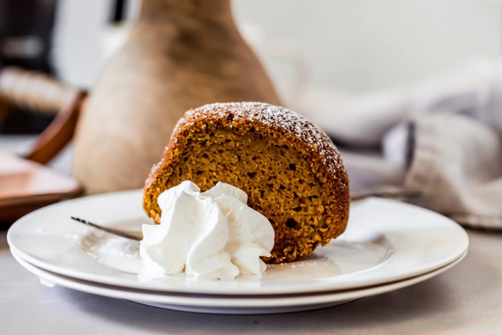 a slice of pumpkin spice bundt cake on a white plate