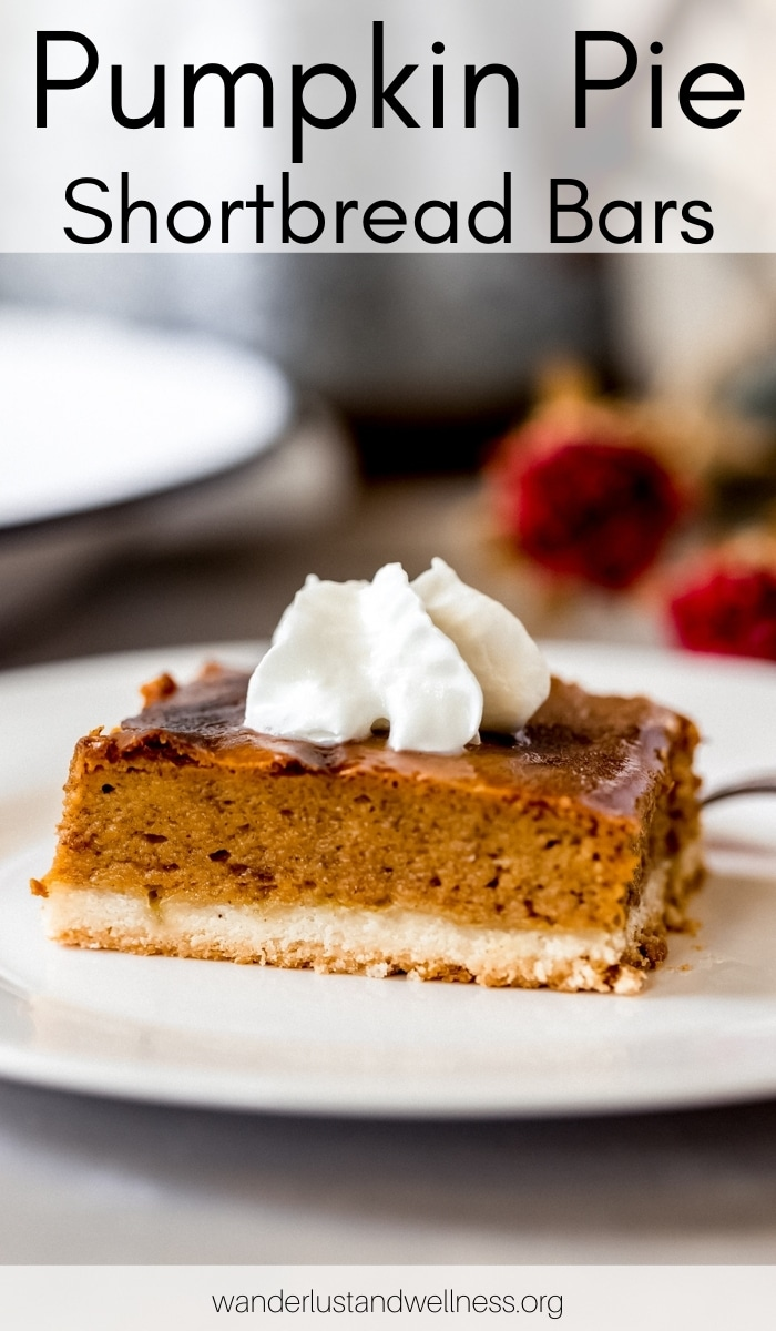 one pumpkin pie shortbread bar on a plate with whipped cream on top