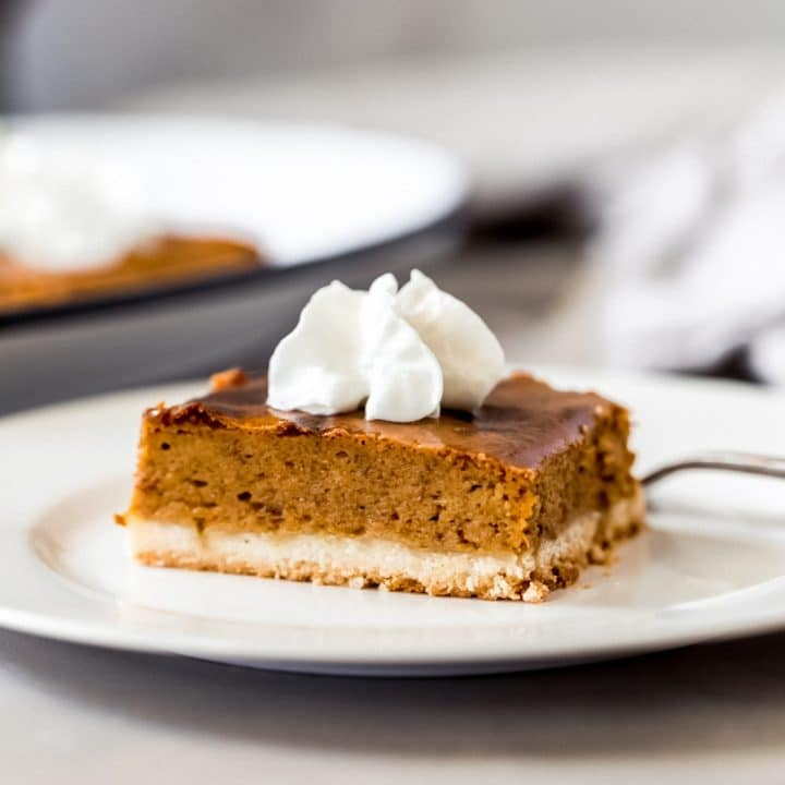 a pumpkin pie shortbread bar on a plate