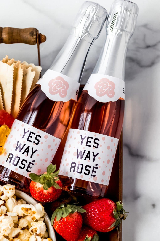 two mini bottles of rosé wine on a date night charcuterie board