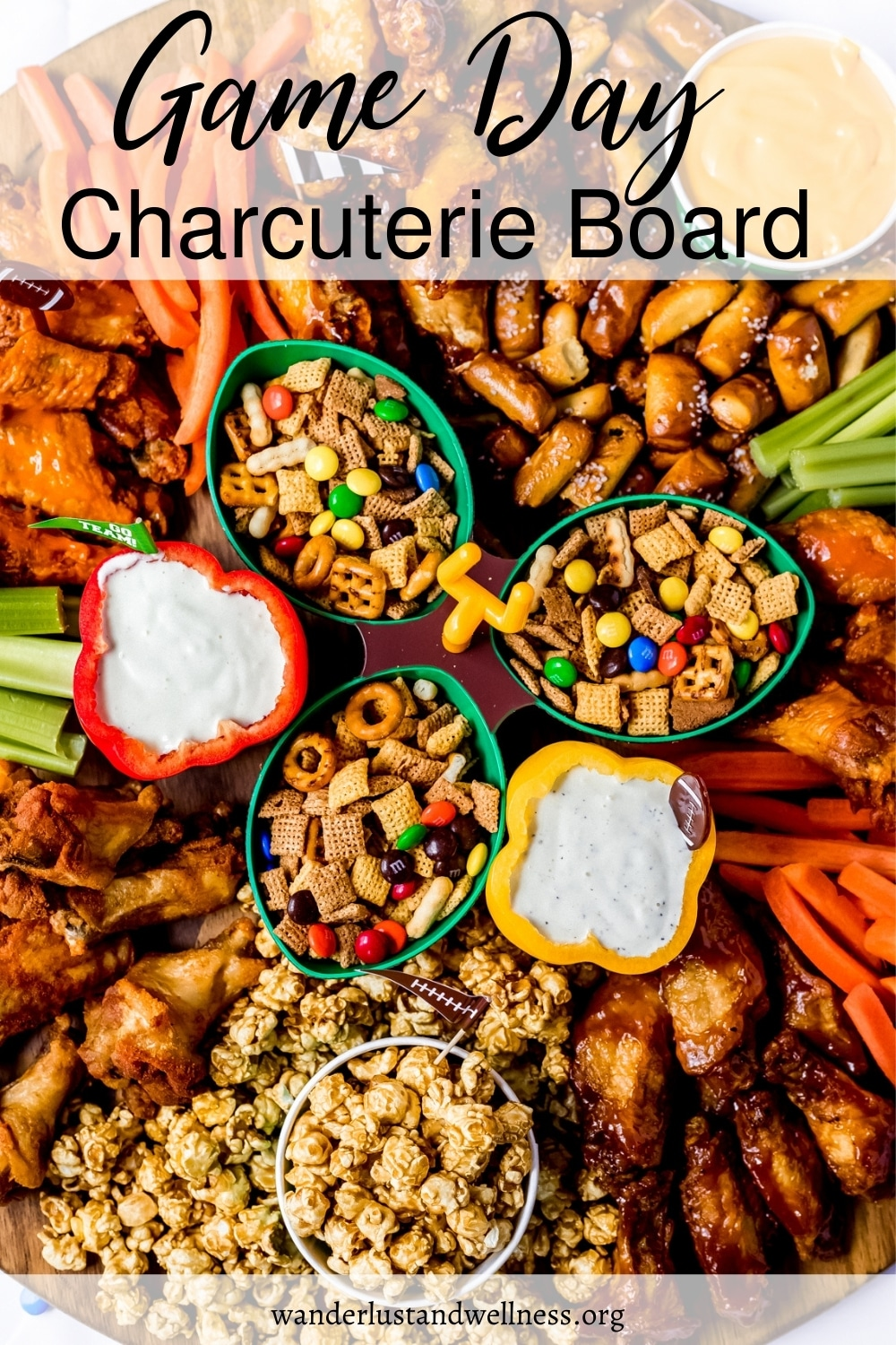 a game day charcuterie board with chicken wings and other party appetizers