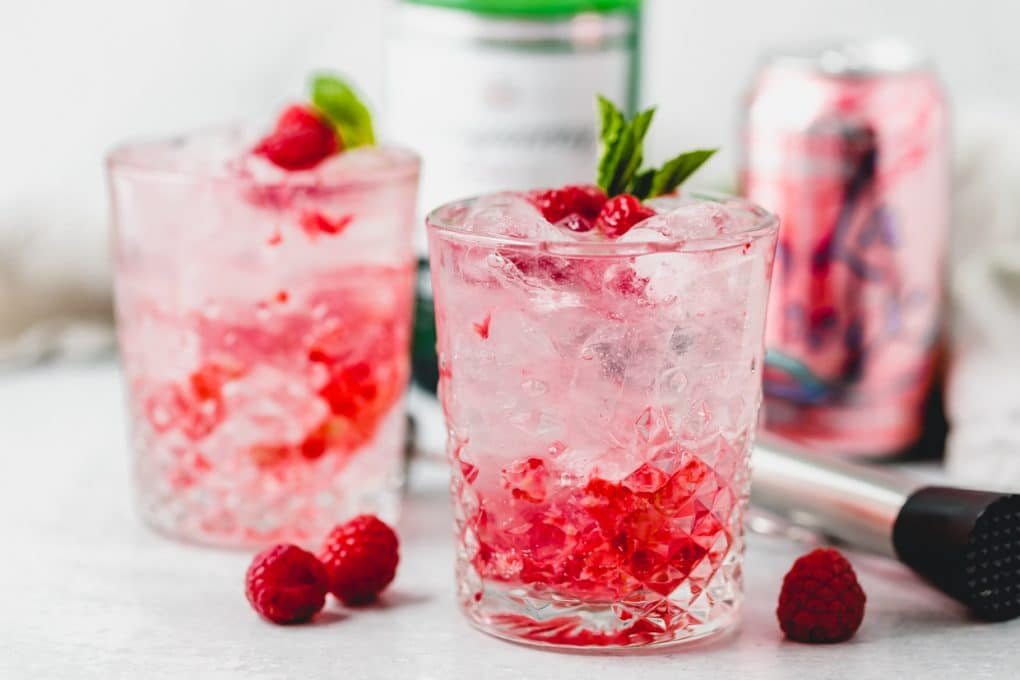 two glasses of razz cranberry la Croix cocktail plus ingredients