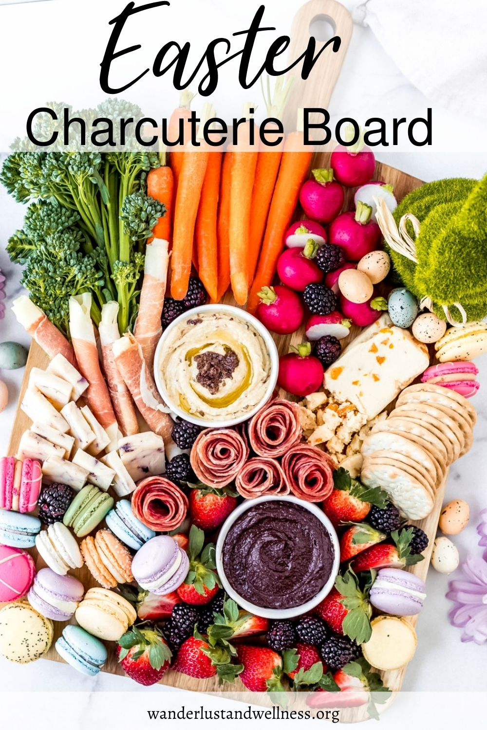 an Easter charcuterie board with fruits, vegetables, meat, cheese and sweet Easter treats