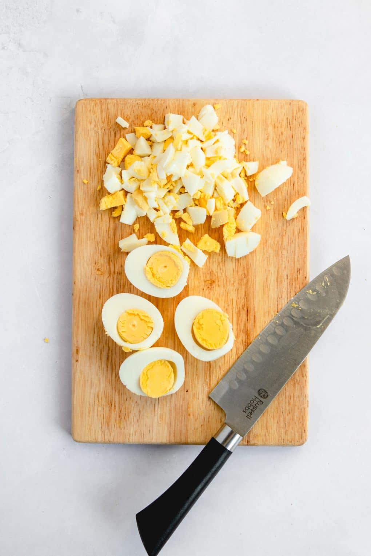 chopped hard-boiled eggs on a cutting board