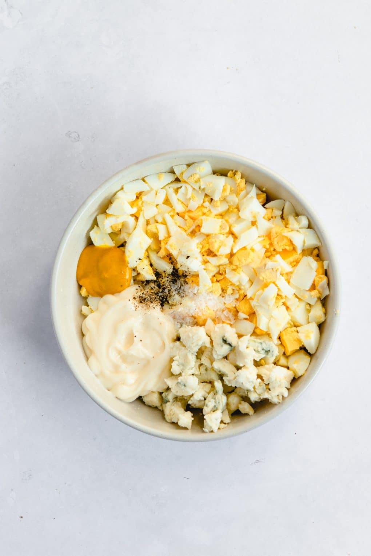 ingredients for egg salad in a bowl