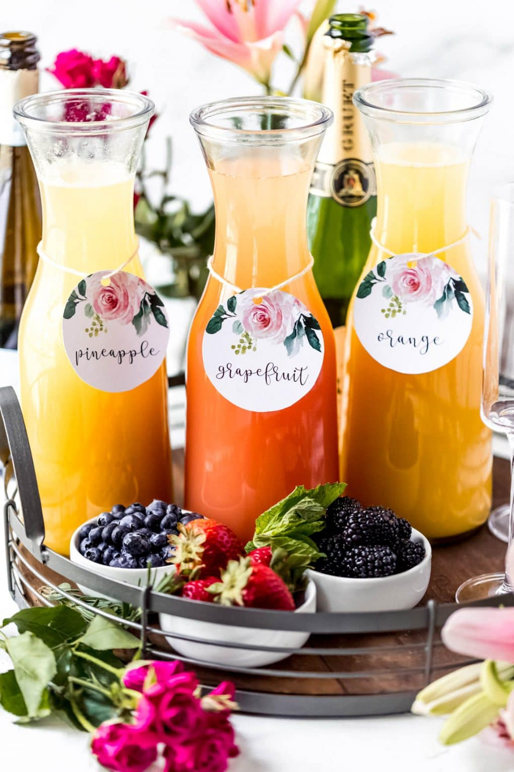 a mimosa board with three types of mimosas