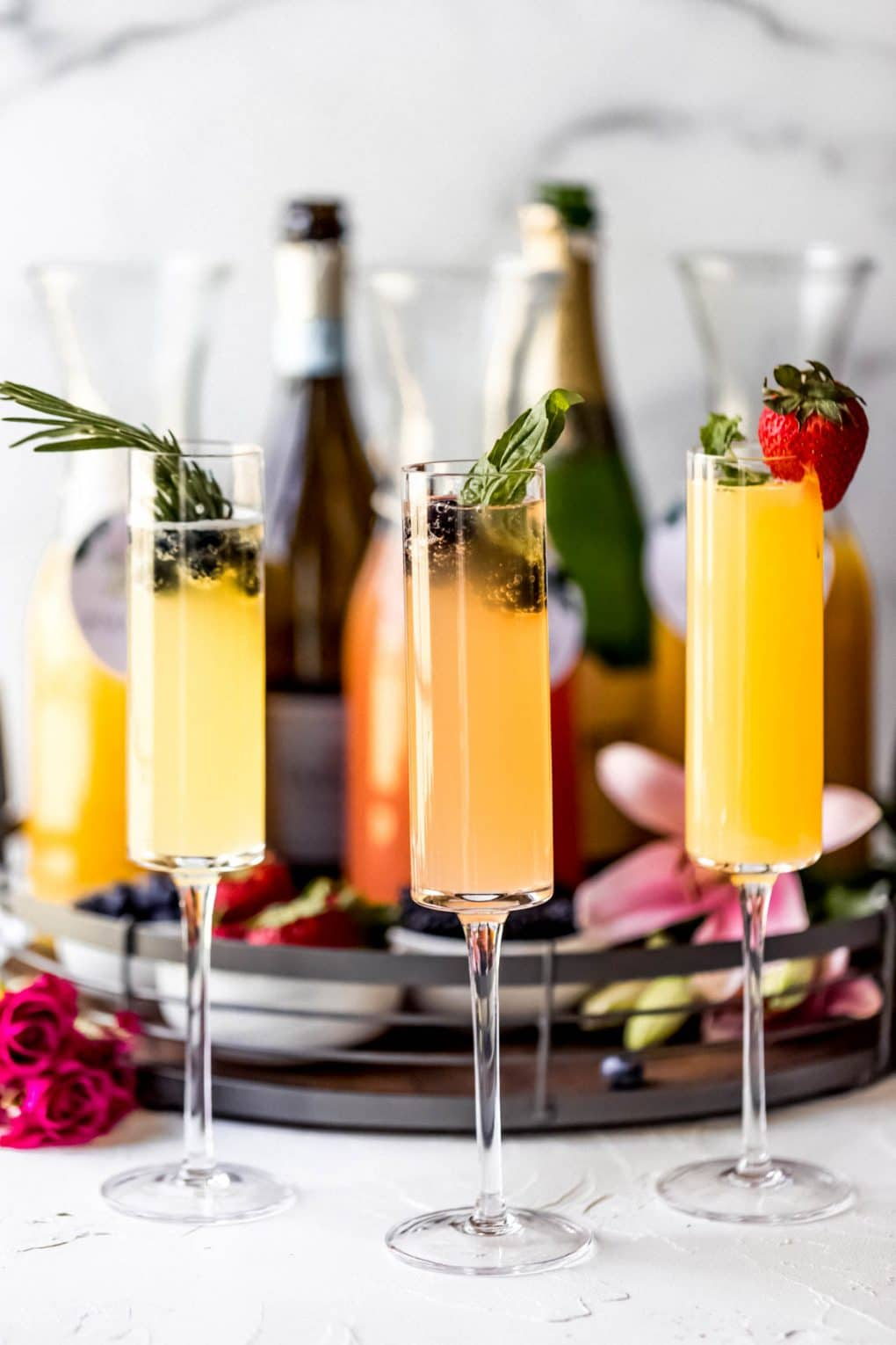 three glasses of mimosas from a mimosa board