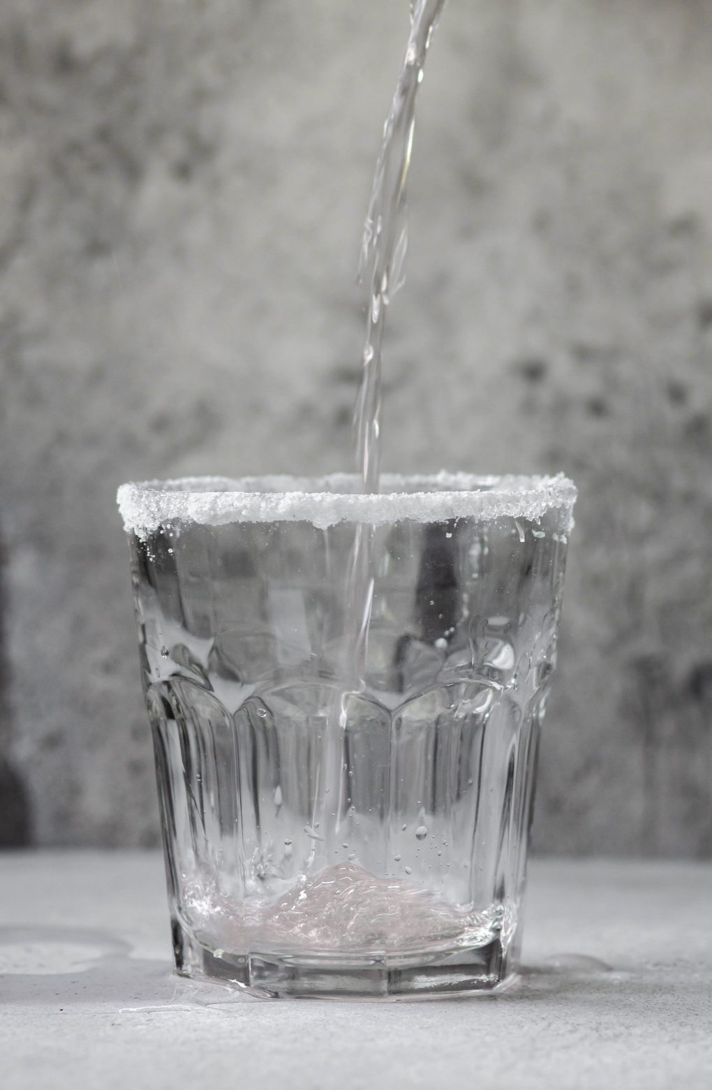 pouring pamplemousse La Croix into a glass